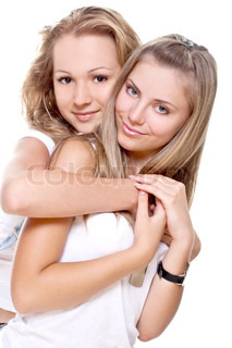 two beautiful women in a white T-shirts on a white background isolated
