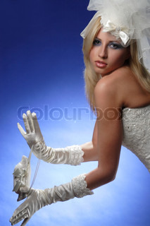 portrait of bride with gloves on a blue background