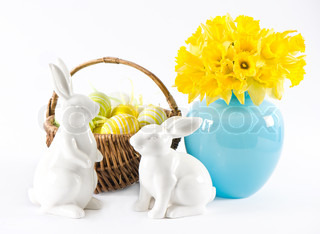 easter decoration with daffodils, rabbits and eggs