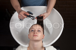 The girl receives pleasures from washing hair in hairdresser's salon