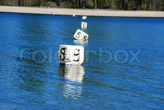 floating white cubes with numbers over blue water