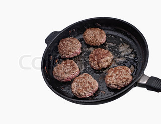 chopped steak frying in a pan isoated on white