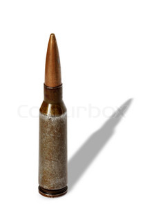 Old rifle cartridge standing on white background isolated with clipping path