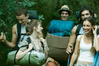 ?Odilon Dimier/AltoPress/Maxppp ; Group of wilderness campers carrying equipment