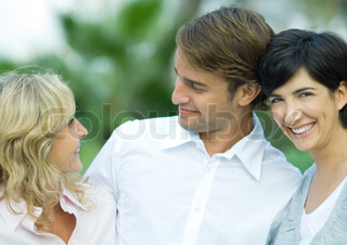 Adult couple with mature woman, smiling