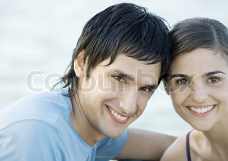 Young couple, head to head, smiling, portrait
