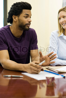Man explaining idea to colleague in meeting