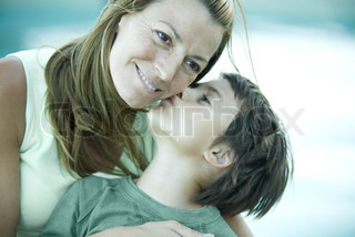 Boy and mother, boy kissing woman's cheek