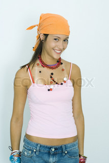 Teen girl wearing lots of accessories, smiling at camera, portrait
