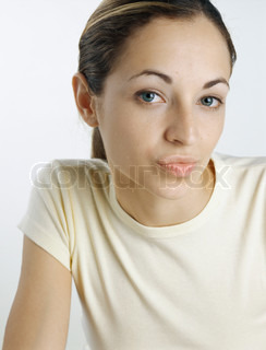 Woman looking at camera with pursed lips, close-up