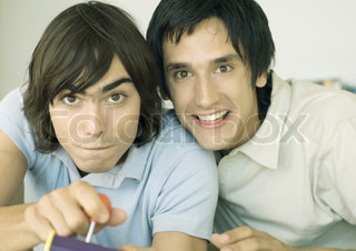 Image of 'adolescent, video games, video game controllers'