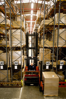 Forklift moving pallets in warehouse