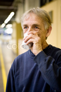 Factory worker drinking cup of coffee