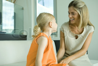 Mother talking to little girl