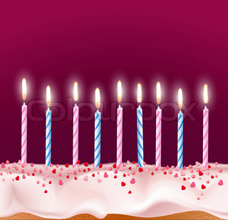 blue and pink candles on a birthday cake
