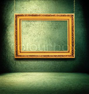 Grunge green interior with golden frame.