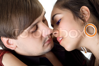 Portrait of passionate kissing couple. Isolated on white