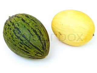 Photo of the yellow and green melon against the white background