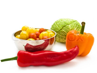 different multicolored vegetables over the white background