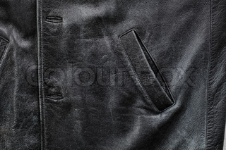 Pocket detail of an old black worn leather jacket