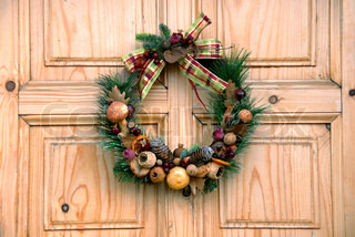 Christmas wreath on wooden door outdoor closeup