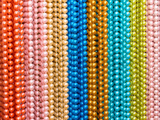 multi-colored beads of various sizes and shapes on the wall