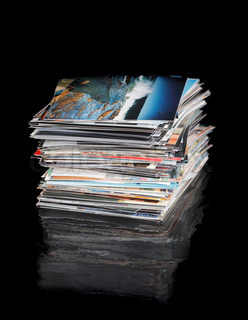 A Stack of 4x6 inch (10x15cm) photos on black reflecting surface. The image on the top of the pile (c) by the photographer of the whole image