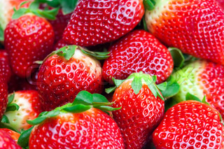 background of red big juicy ripe strawberries