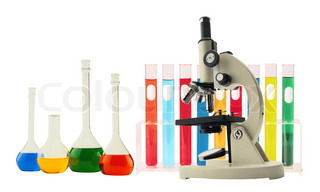 Laboratory metal microscope and test tubes with liquid on white