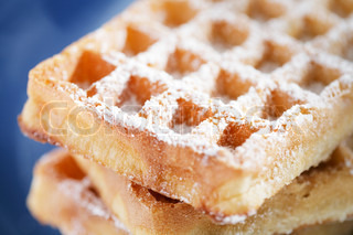 Closeup of waffles with sprinkled sugar. Very short depth-of-field.