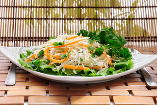 summer salad of cabbage with carrots and greens