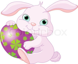 Small lovely Easter rabbit holds Easter Egg