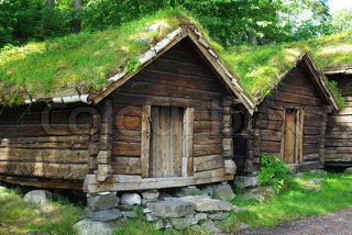 Ancient fisherman's  wooden huts  in ethnic park of Alesund, Norway