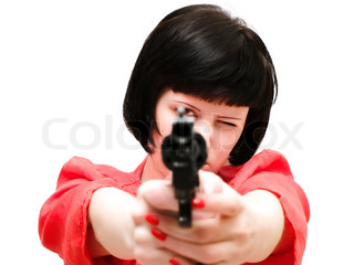 woman with pistol in red against the white background