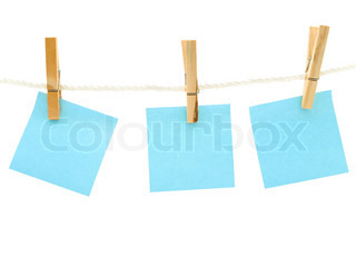 blue blank notes at the peg against white background