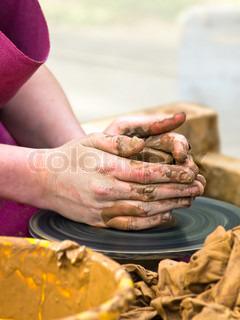 Photo of the potter worker hands at work