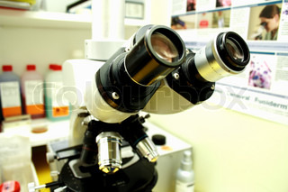 Close up of microscope lenses focused on a specimen