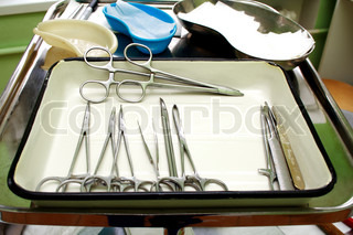 Surgical instruments in a steel tray for operation