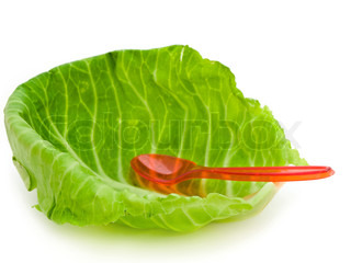 photo of the cabbage leaf and spoon against the white background