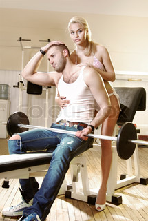 courting couple in exercise room, man and woman have tender love story