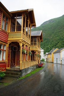 Traditional wooden houses on hillside background in Lyrdal, Norway