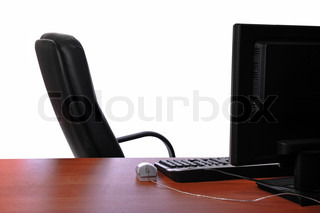Empty Office Chair And Desk With Computer Keyboard