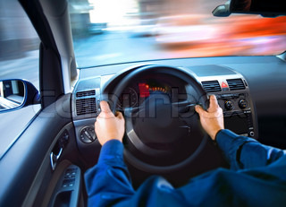 hands of driver that sits on driver's seat and turning wheel
