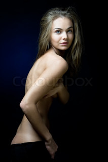 Portrait of the beautiful woman with naked torso