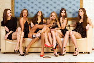Group of the beautiful model in a black dresses