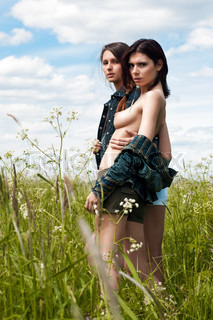 Two beautiful young women at the meadow