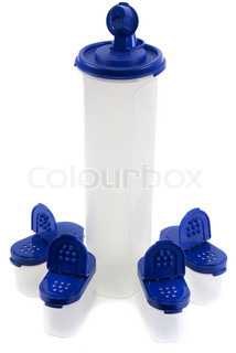 Saltcellar and plastic bottle from translucent plastic arts with blue lid on white background