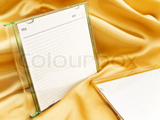 cd disc with blank cover over the gold background