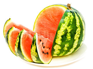 red melon with slice at plate against the white background