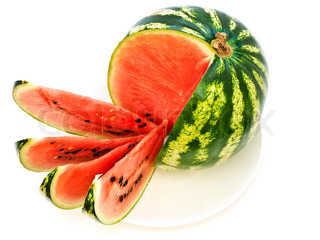 big melon with slices at plate against the white background